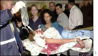 A victim of the bomb blast arrives at the hospital in Netanya