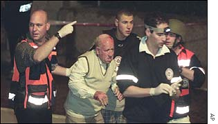 A victim is led from the scene