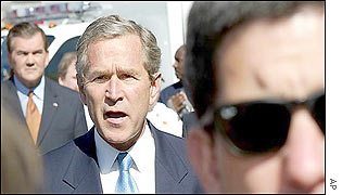 Bush with security man
