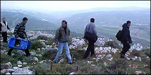 Palestinians walking to Nablus