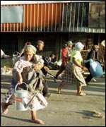 [ image: Looting and arson left central Maseru in ruins]