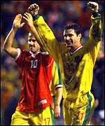 [ image: John Robinson and Gary Speed celebrating victory]