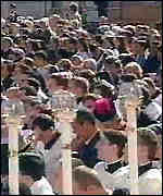 [ image: Worshippers attend the canonisation service in St Peter's Square]