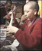 [ image: Nuns cutting extracts out of religious books]