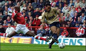 Arsenal striker Thierry Henry opens the scoring