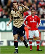 Arsenal's Fredrik Ljungberg celebrates scoring