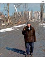 Elderly Grozny resident holding a white flag