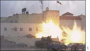 Explosions can be seen in front of cars at Yasser Arafat's Ramallah compound