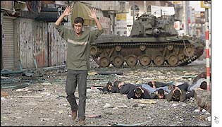 Palestinian with hands raised in surrender