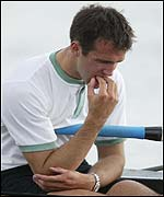 Tom Stallard sits inconsolable in the Cambridge boat after the defeat
