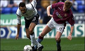 Youri Djorkaeff and Steve Staunton battle for the ball