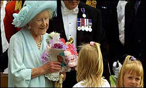 Queen Mother receiving flowers on 101st birthday