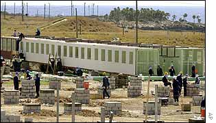 Workmen at the site of the new permanent facility on Guantanamo