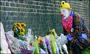 A clown leaves his tribute at St James's Palace