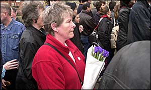 Lynne Robertson waits in the crowd