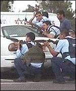 Israeli soldiers return fire at the gunmen
