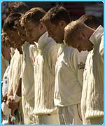 England and New Zealand cricketers stand in silence before their match