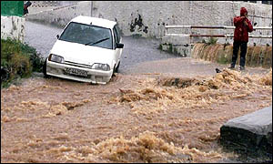 Mud cascades down a road in Tenerife's capital, Santa Cruz