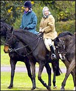 The Queen and Princess Anne riding in the grounds of Windsor Castle