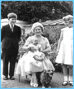 Prince Charles and Princess Anne with the Queen Mother who holds baby Prince Andrew