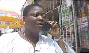 A Lagos trader on the phone to a customer