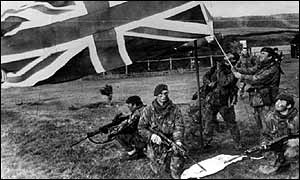 British troops raise their flag on the Falklands during the war in 1982