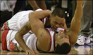 Juan Dixon jumps on top of Lonny Baxter after secuing the NCAA title