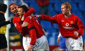 Manchester United midfielder David Beckham is congratulated on his opener by Nicky Butt and Paul Scholes