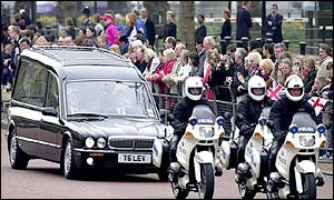 Hearse travelling with police escort