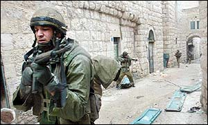 Israeli soldier patrolling near the Church of the Nativity