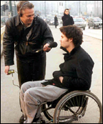 Faruk Sabanovic being interviewed by George Arney on the main streets of Sarajevo