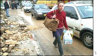 A woman walks through the streets of Ramallah