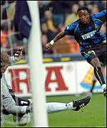 Inter Milan's Mohammed Kallon's shot is saved by Feyenoord goalkeeper Edwin Zoetebier