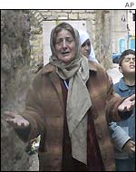 A Palestinian woman cries in Bethlehem