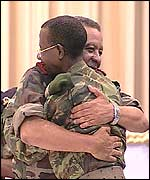 Unita Chief of Staff Gen. Geraldo Abreu Kamorteiro (l) and Angolan armed forces chief Gen. Armando da Cruz Neto (r)  hug