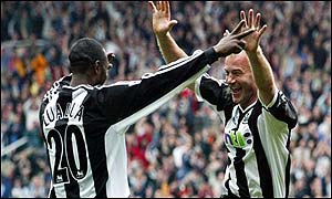 Lomano Tresor Lua-Lua celebrates with Alan Shearer after another goal