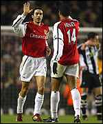 Robert Pires and Thierry Henry celebrate a goal for Arsenal