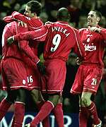 Footballers celebrating a goal