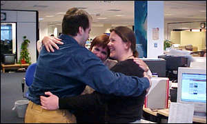 Business News Online staff try out a group hug
