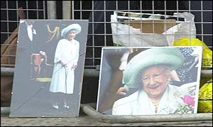 Pictures of the Queen Mother lining the route