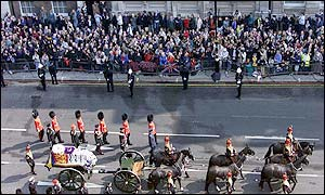 The funeral procession is escorted into Old Palace Yard, Westminster