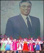 North Korean children against backdrop of the late-president, Kim Il-sung