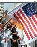 Protesters against Musharraf's policies burn a US flag