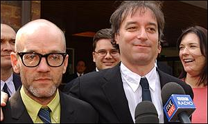 Mr Buck (right) was supported at the trial by singer Michael Stipe