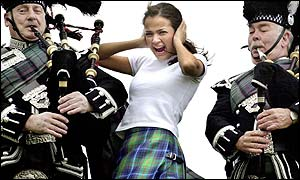 A model shows off the new, New York tartan