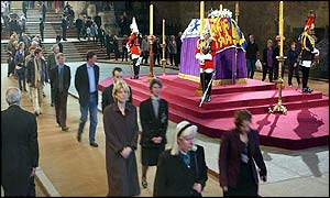 Mourners file past the Queen Mother's coffin