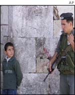 Palestinian boy and Israeli soldier in Jerusalem