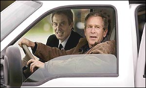 George Bush drives Tony Blair in his truck at the Prairie Chapel ranch
