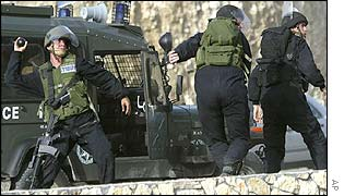 Israeli soldiers throw stun grenades at Arab-Israelis