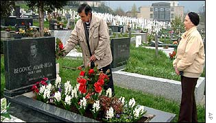 Rifat, left, and Ljiljana Begovic visit the grave of their only son, Almir